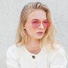 Gouden pilotenbril met roze glazen