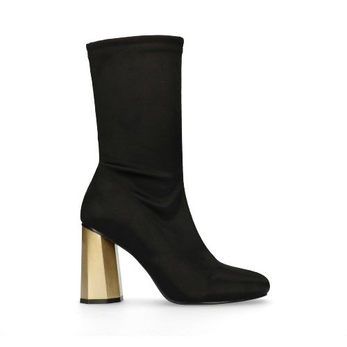Schwarze Sock Boots mit goldenem Absatz