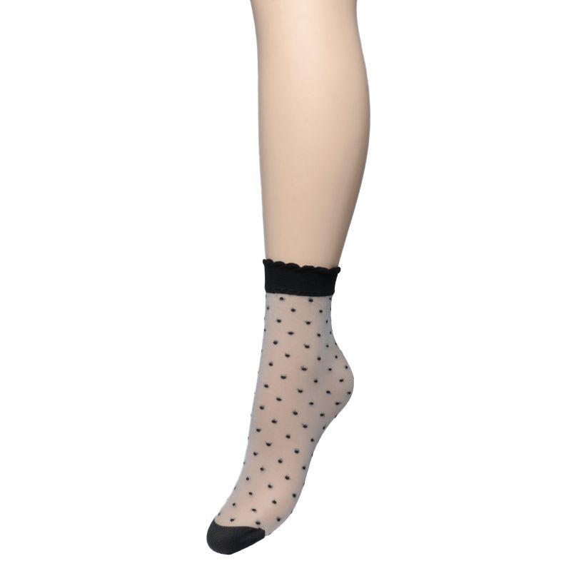 Transparante sokken met zwarte stipjes