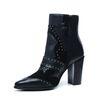 Zwarte western boots met hak en studs