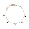 Goldfarbenes Armband mit schwarzen Perlen