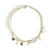 Bracelet de cheville avec pièces et perles - doré