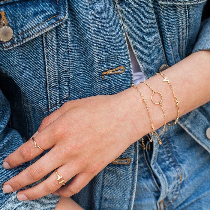 Goldfarbenes Armband mit V-Anhängern