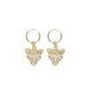 Goldene Ohrringe mit Gepardenkopf-Anhänger