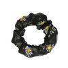 Schwarzer Scrunchie mit Gänseblümchen