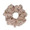 Oudroze scrunchie met stippen