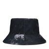 Reversible bucket hat tie dye en zwart