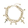 goudkleurige dubbele armband met bedeltjes
