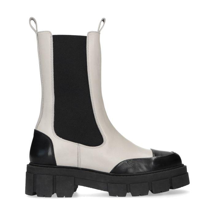 Latte chelsea boots met zwarte details