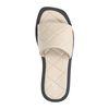Beige leren slippers met ruitpatroon