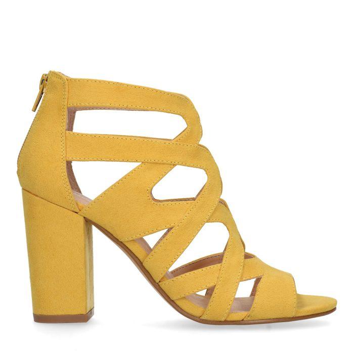 Gele opengewerkte pumps