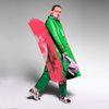 Beigefarbene Sneaker mit lila Details