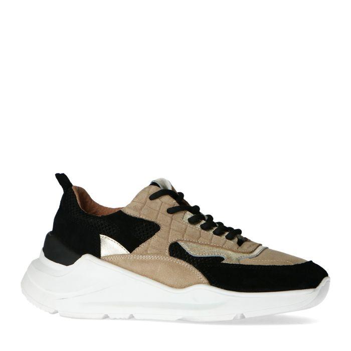 Schwarze Sneaker mit goldenen Akzenten