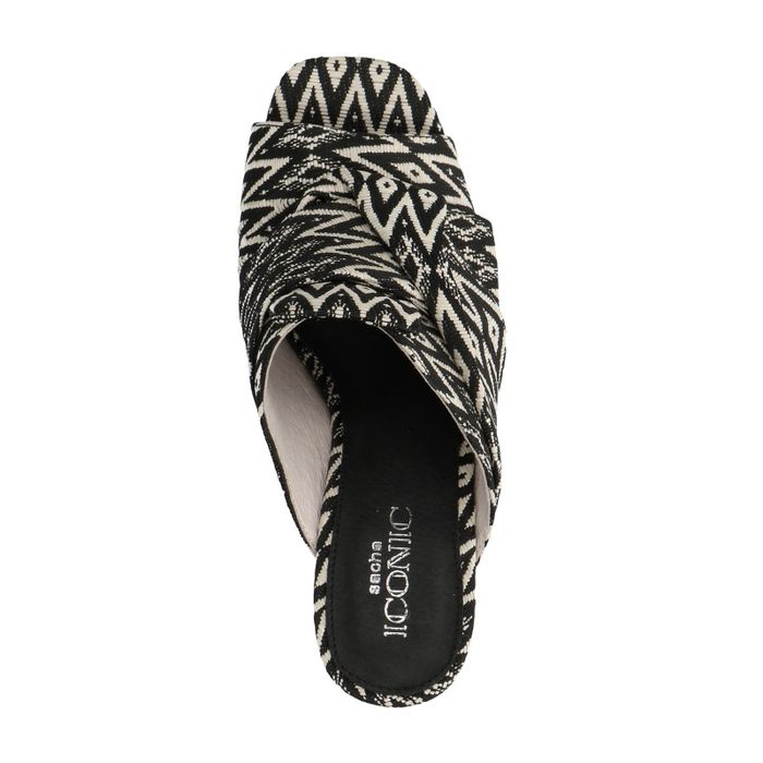 Mules mit schwarz-weißem Muster