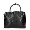 Schwarze Lack-Handtasche mit Schlangenmuster